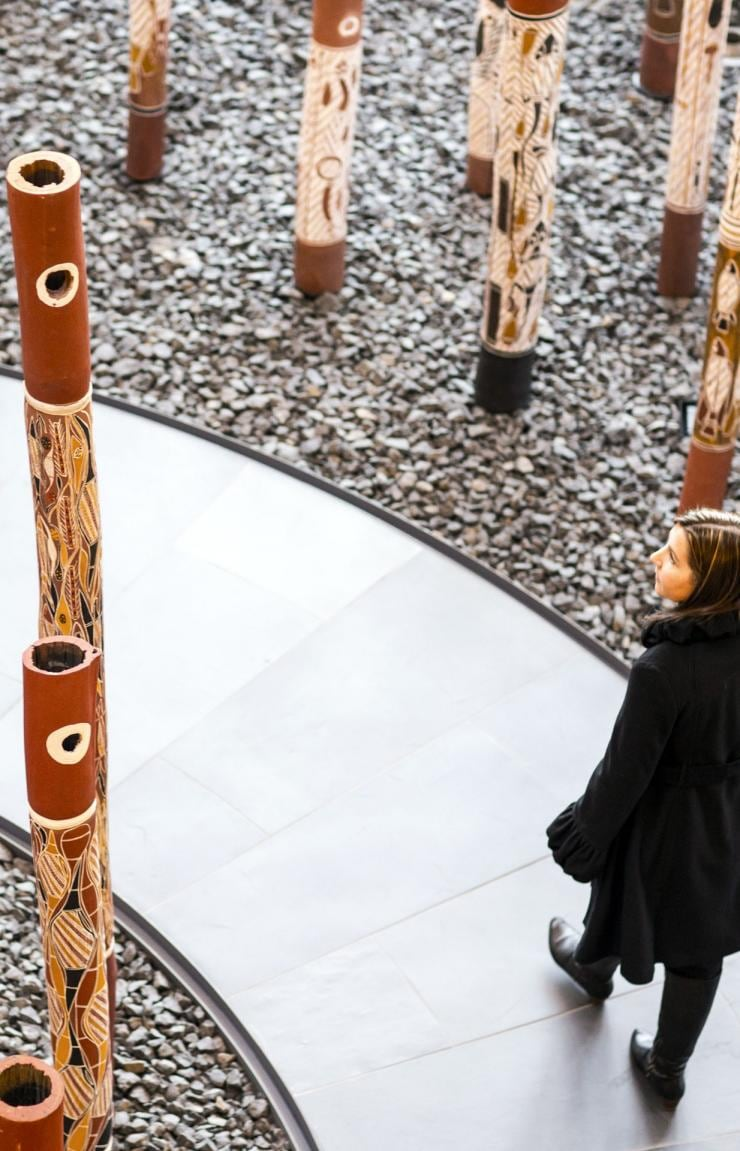 Woman walking through National Gallery of Australia in Canberra © Visit Canberra