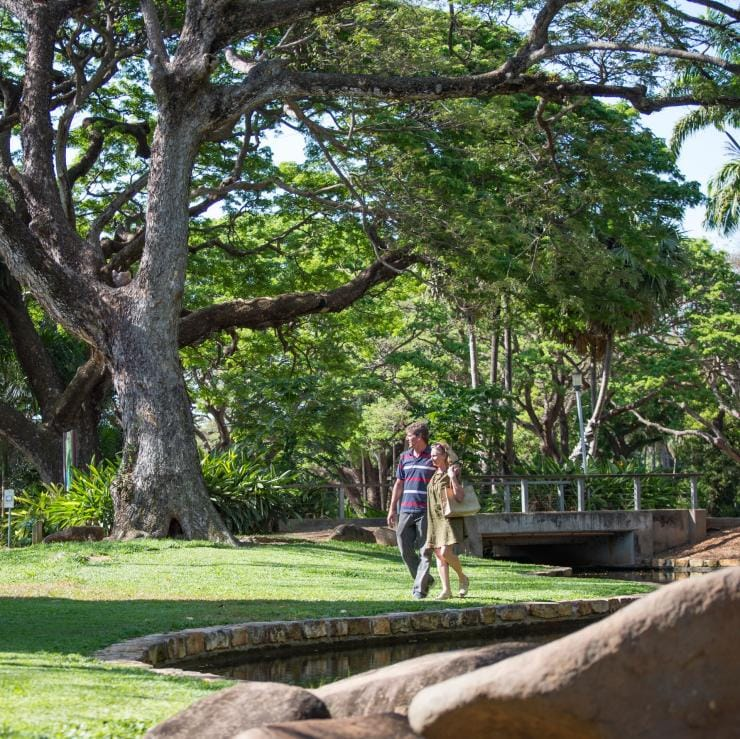 Couple walking through the George Brown Darwin Botanic Gardens in Darwin © Tourism NT/Shaana McNaught
