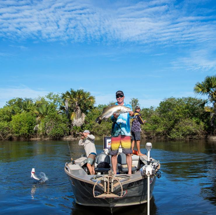 Fisherman showing their catch during a tour with Dhipirri Barra & Sportfishing Lodge © Tourism NT/Shaana McNaught