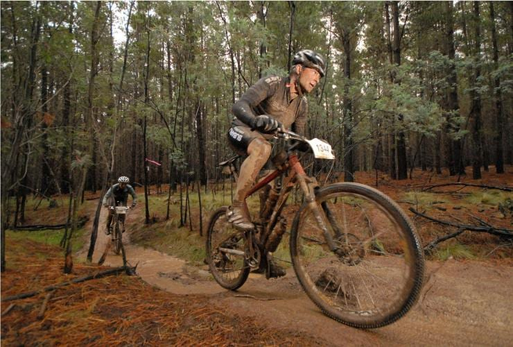 Mountain bikers riding a trail at Stromlo Forest Park © Auroroa Images