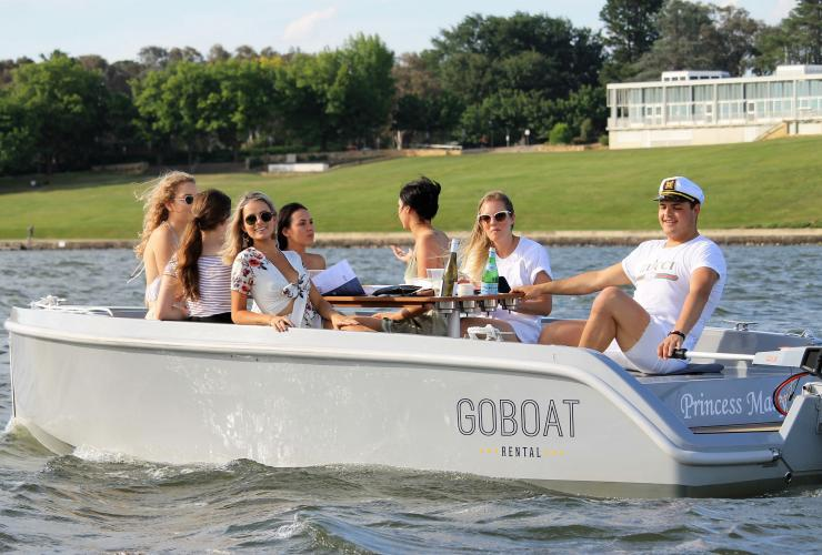 Friends enjoying a floating picnic on a Go Boat on Lake Burley Griffin © Go Boats/Visit Canberra