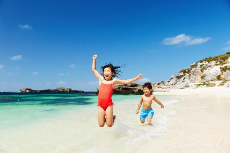 Two children playing on the beach at Rottnest Island © Rottnest Island Authority