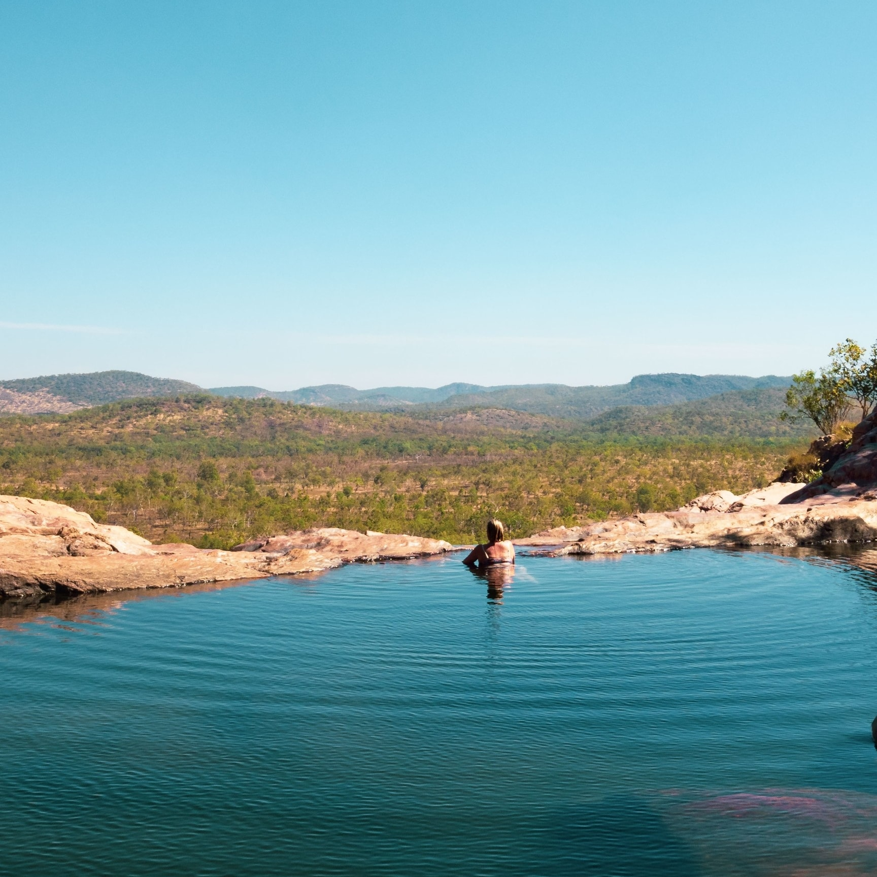 A woman looking out from the Gunlom plunge pool in Kakadu National Park © Tourism Tasmania/Rob Burnett