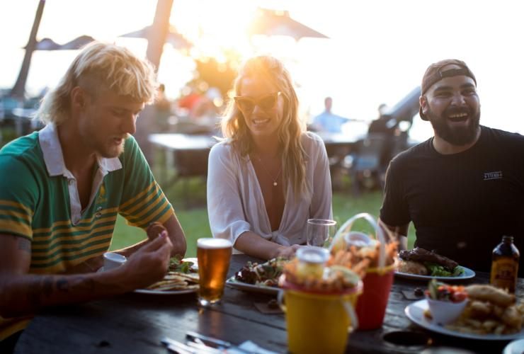 Friends enjoying dinner at Darwin Ski Club © Tourism NT/Cait Miers