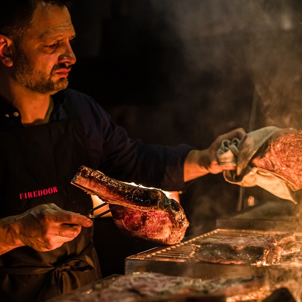 Chef cooking meat at Firedoor restaurant in Sydney © Nikki To