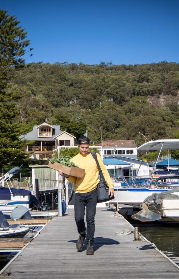 Hayden Quinn carries fresh vegetables to a boat on the Hawkesbury River © Boomtown Pictures