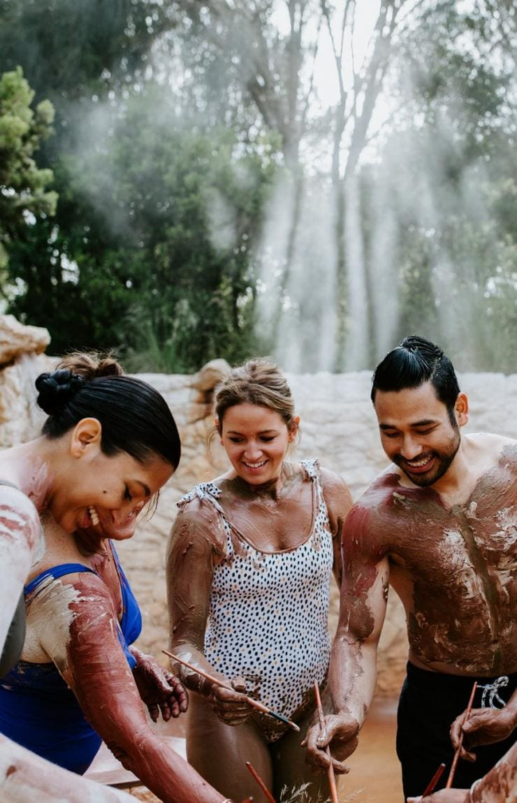 Group of friends participate in a body clay ritual at Peninsula Hot Springs © Peninsula Hot Springs