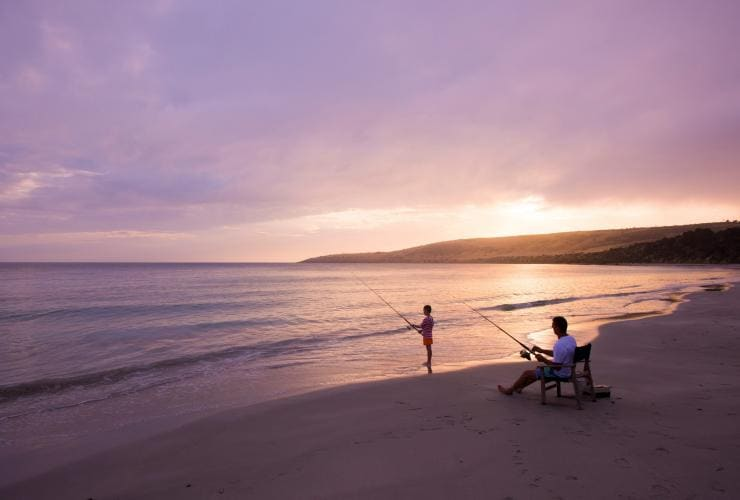 Two people fishing on the beach at sunset on Kangaroo Island © South Australian Tourism Commission