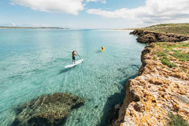 Paddleboarders paddling in the ocean in Shark Bay World Heritage Area © Tourism Western Australia/Mark Boskell