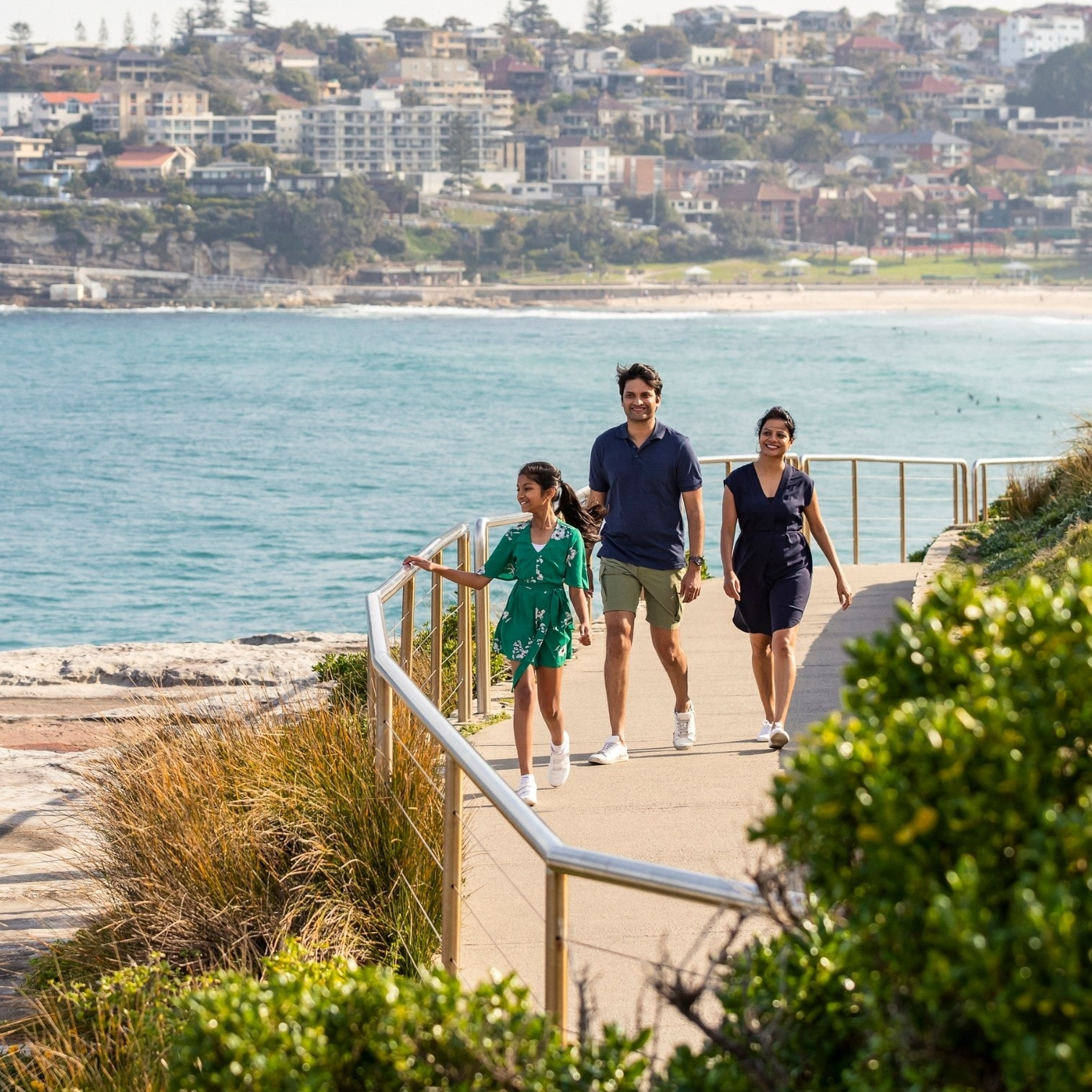 Family walking on path along the coastline on Bondi to Bronte walk © Destination NSW