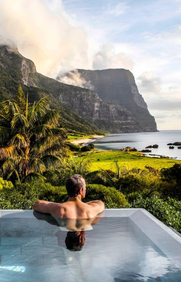 Swimmer at the edge of an infinity pool at Capella Lodge looking out over Lord Howe Island © Baillie Lodges/Capella Lodge