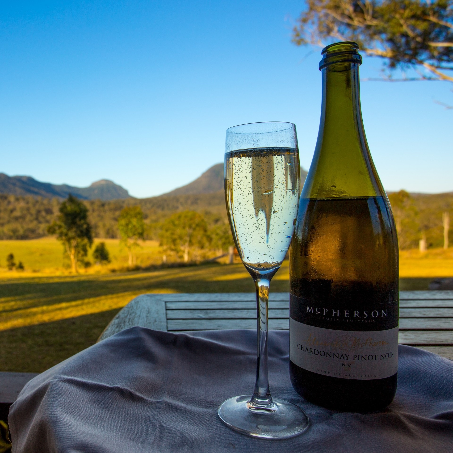 Wine bottle and glass at Spicers Canopy Camp © Spicers Retreat / Great Walks of Australia