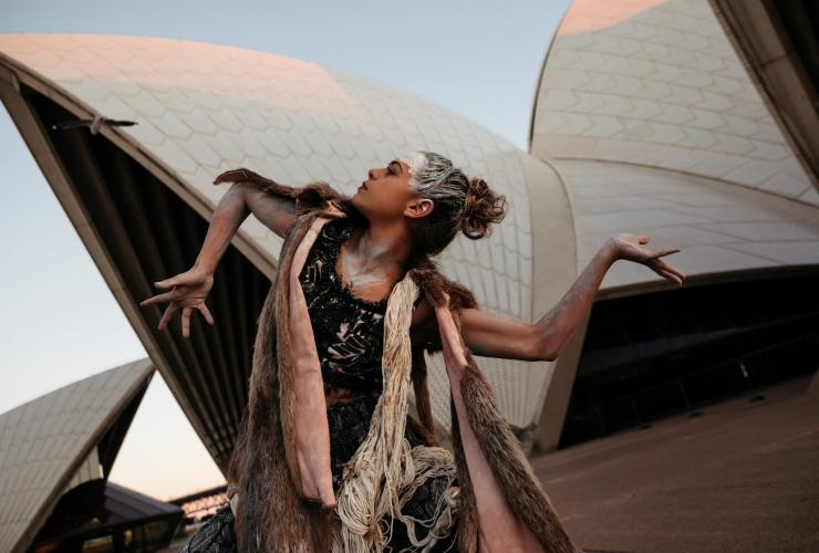 Bangarra Dance Theatre dancer Lillian Banks performs outside the Sydney Opera House © Bangarra Dance Theatre/Daniel Boud