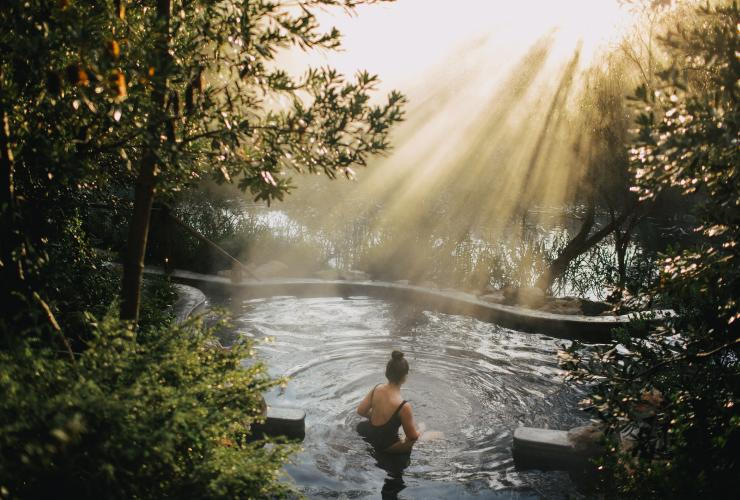 Young woman sits in a hot spring at Peninsula Hot Springs © Peninsula Hot Springs