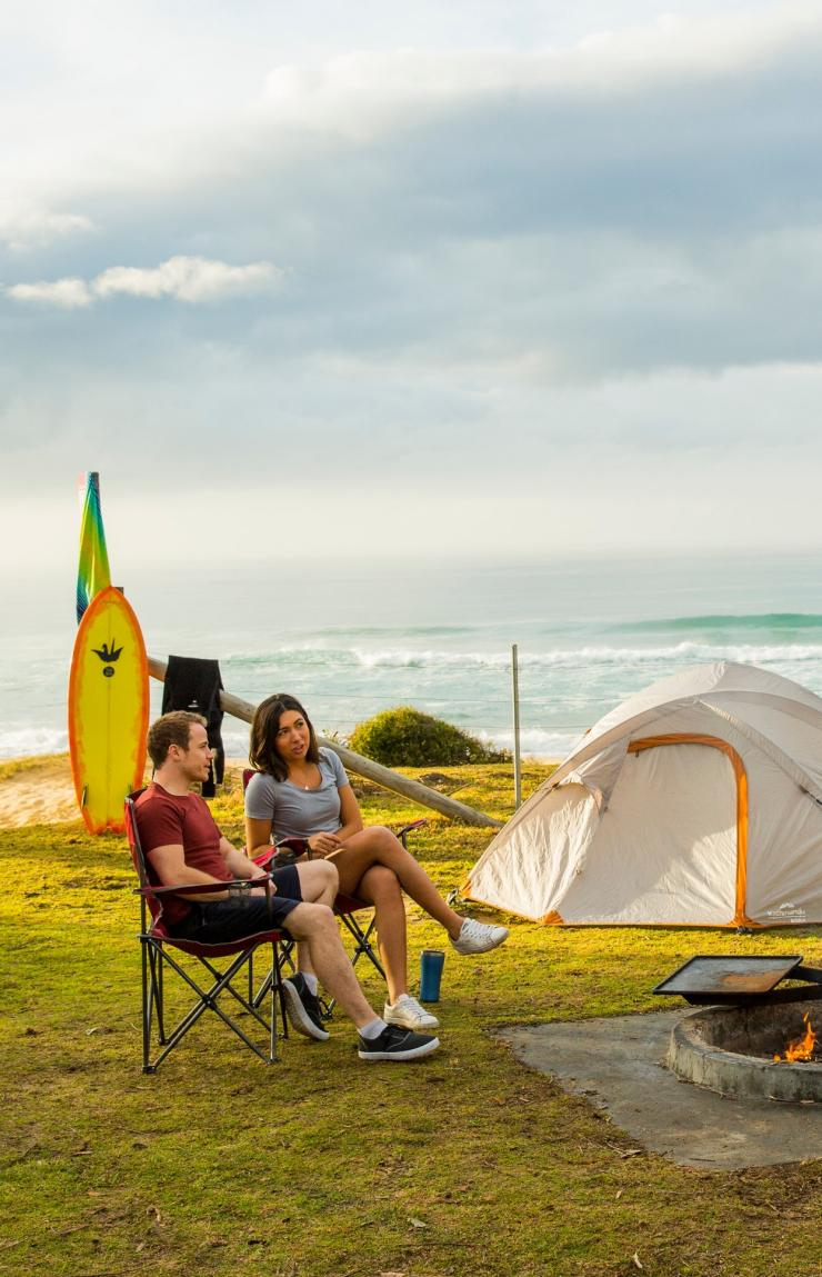 Two people sat a Gillards Campground © Destination NSW
