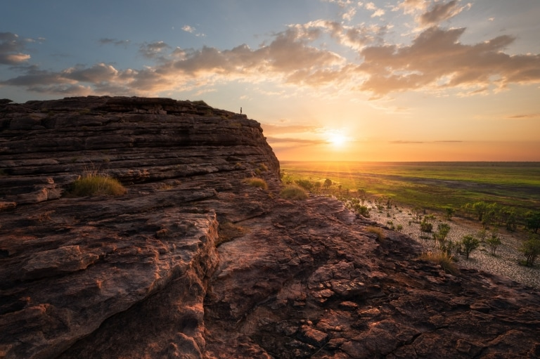 Man standing on the top of the rock in Ubirr, Kakadu National Park © Tourism NT/Daniel Tran