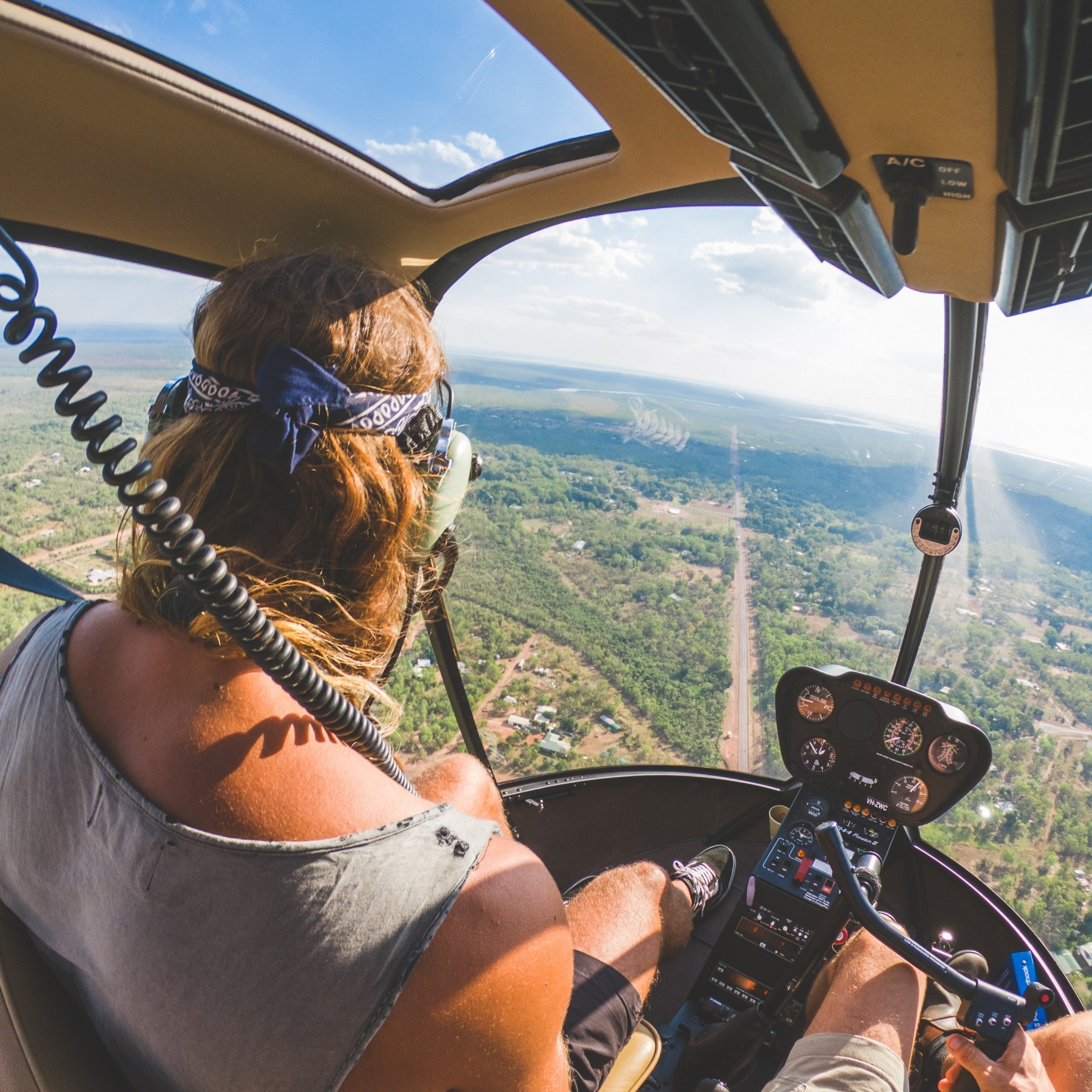 Girl in helicopter over Litchfield National park © Tourism NT - Dan Moore