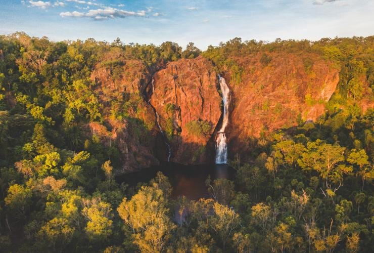 Wangi Falls against red cliffs in Litchfield National Park © Tourism NT/Lucy Ewing