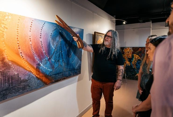 Looking at the art with artist at Birrunga Gallery & Dining, Brisbane, Queensland © Jesse Lindemann, Tourism and Events Queensland