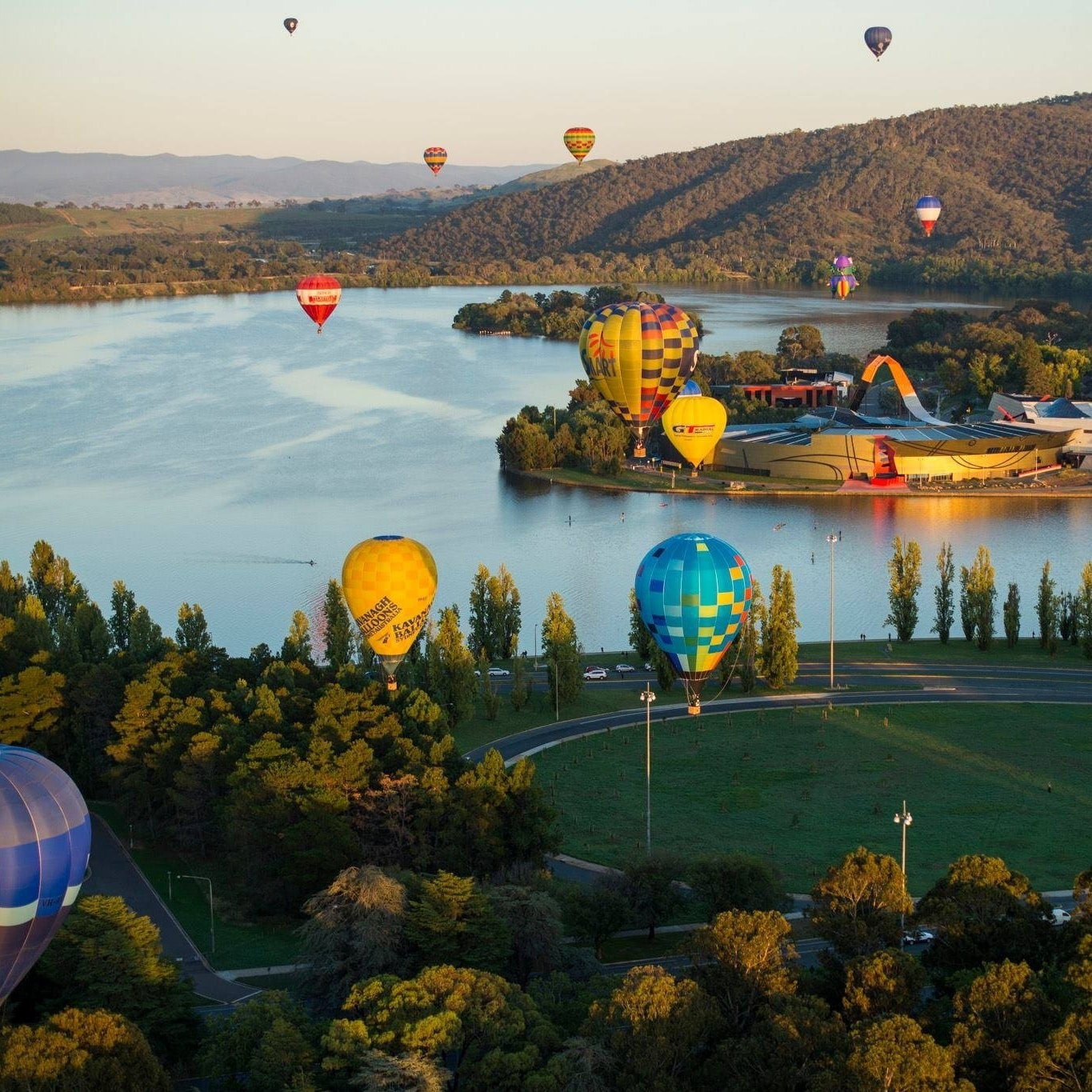Hot air balloons floating above Luke Burley Griffin © Martin Ollman