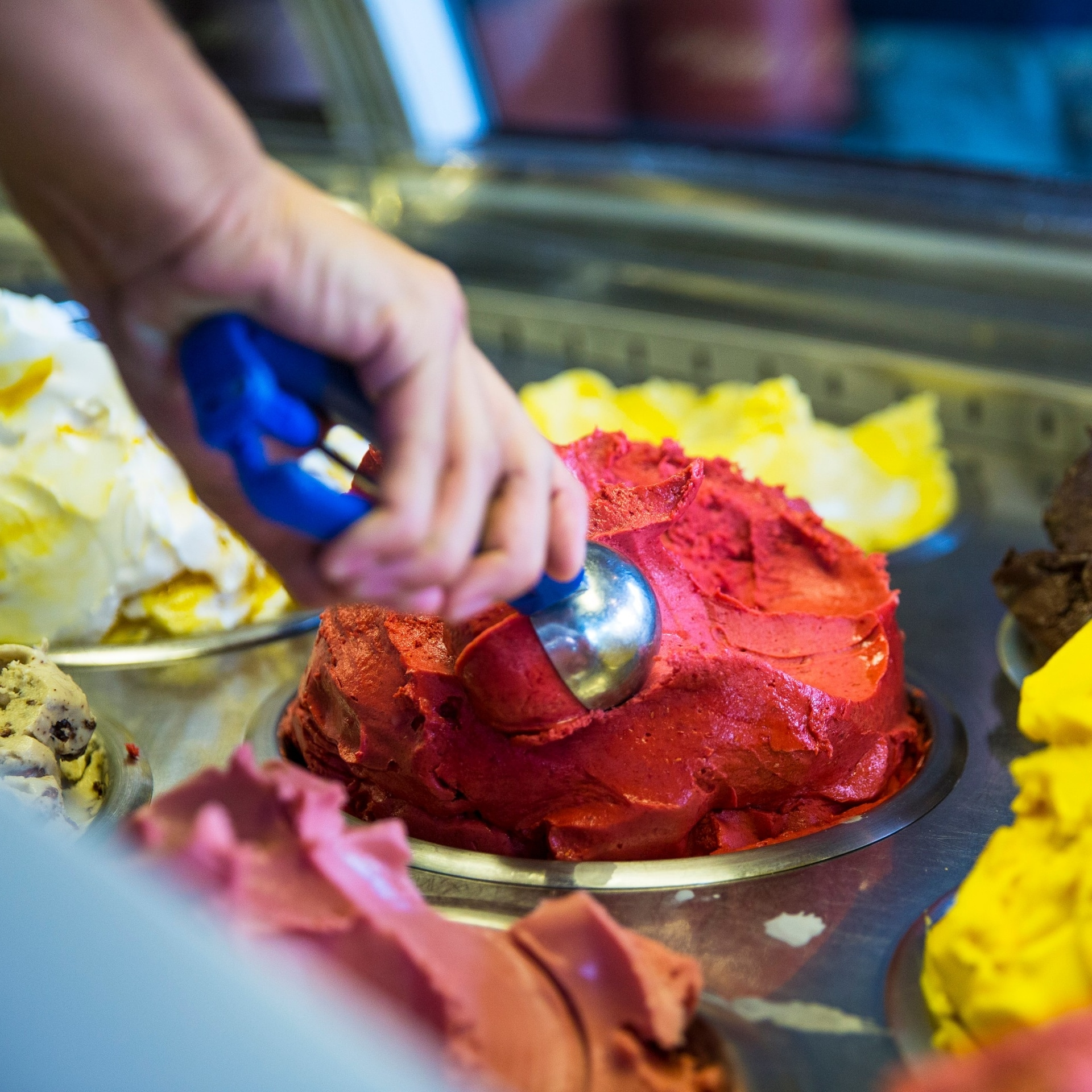 Hand scoops ice cream at Gelato Messina store © Josie Withers/Visit Victoria