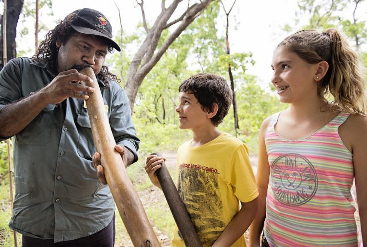 Kids learning to play the didgeridoo on a Pudakul Aboriginal Cultural Tour © Shaana McNaught