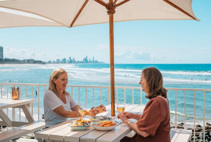 Women dining at Burleigh Pavilion on the Gold Coast © Destination Gold Coast