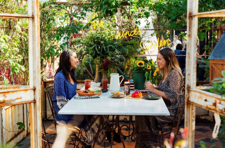 Two women enjoying a meal at The Grounds of Alexandria, Sydney, New South Wales © Destination NSW