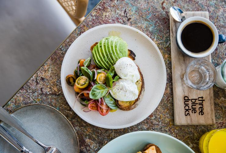 Avocado and poached eggs on toast at Three Blue Ducks, Bronte, New South Wales © Destination NSW