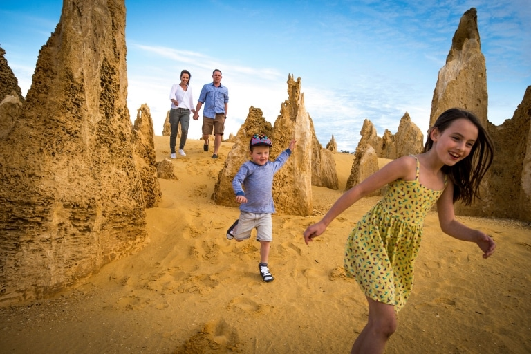 Family exploring the Pinnacles, Nambung National Park in Western Australia © Tourism Western Australia/David Kirkland