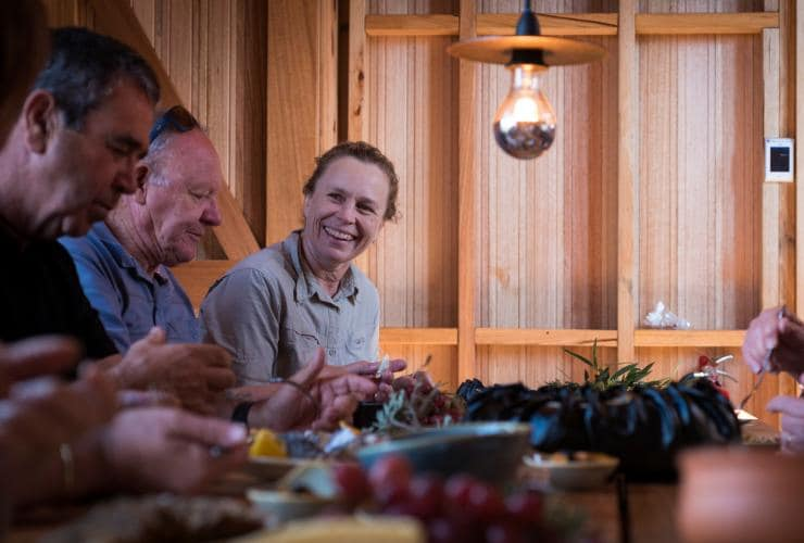 Hikers on the Wukalina Walk enjoying a meal together © Tourism Tasmania/Rob Burnett