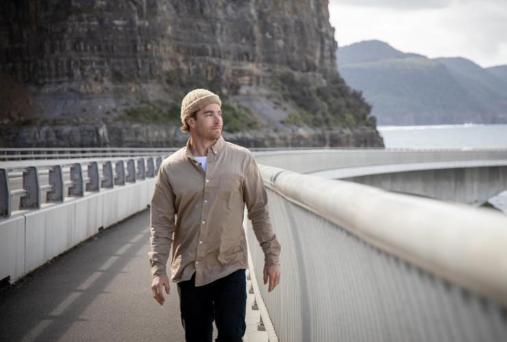 Hayden Quinn walks along the Sea Cliff Bridge in Wollongong © Boomtown Pictures