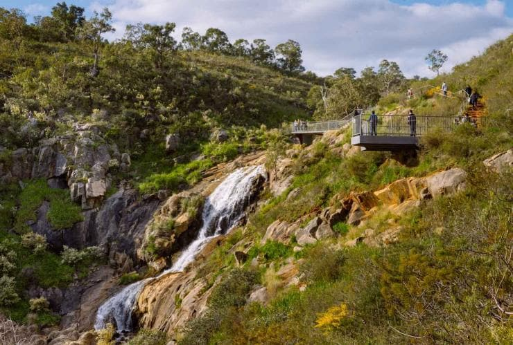 Visitors stand at viewing platform overlooking Lesmurdie Falls in Perth © Tourism Western Australia