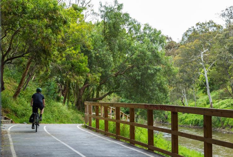 Cyclist rides on trail near Abbotsford Convent in Melbourne © Roberto Seba