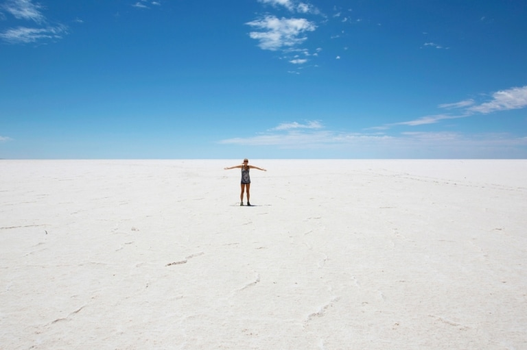 Person standing on the salt flats at Kati Thanda-Lake Eyre National Park © Allan Dixon/South Australian Tourism Commission