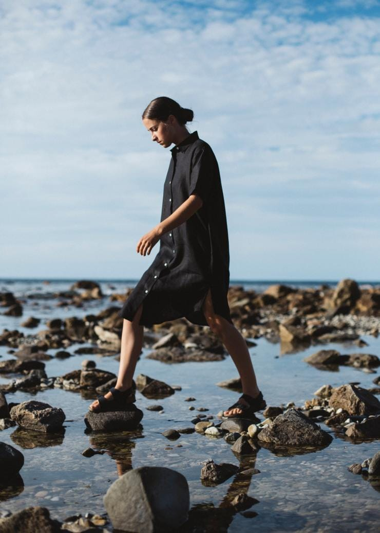 Woman walking over rock pools wearing clothing by Good Studios in Adelaide © Bing Rowland