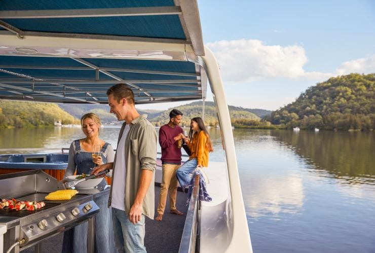 Group of friends on a houseboat on the Hawkesbury River ©  Destination NSW