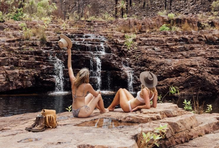 Girls relaxing in from of a waterfall in the Northern Territory © Tourism NT/Ashley Dobson