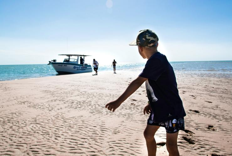 Boy on the beach at Karumba  © Tourism and Events Queensland