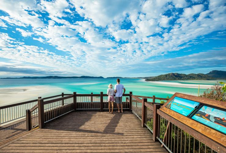Couple looking out to Hill Inlet in the Whitsundays © Tourism and Events Queensland