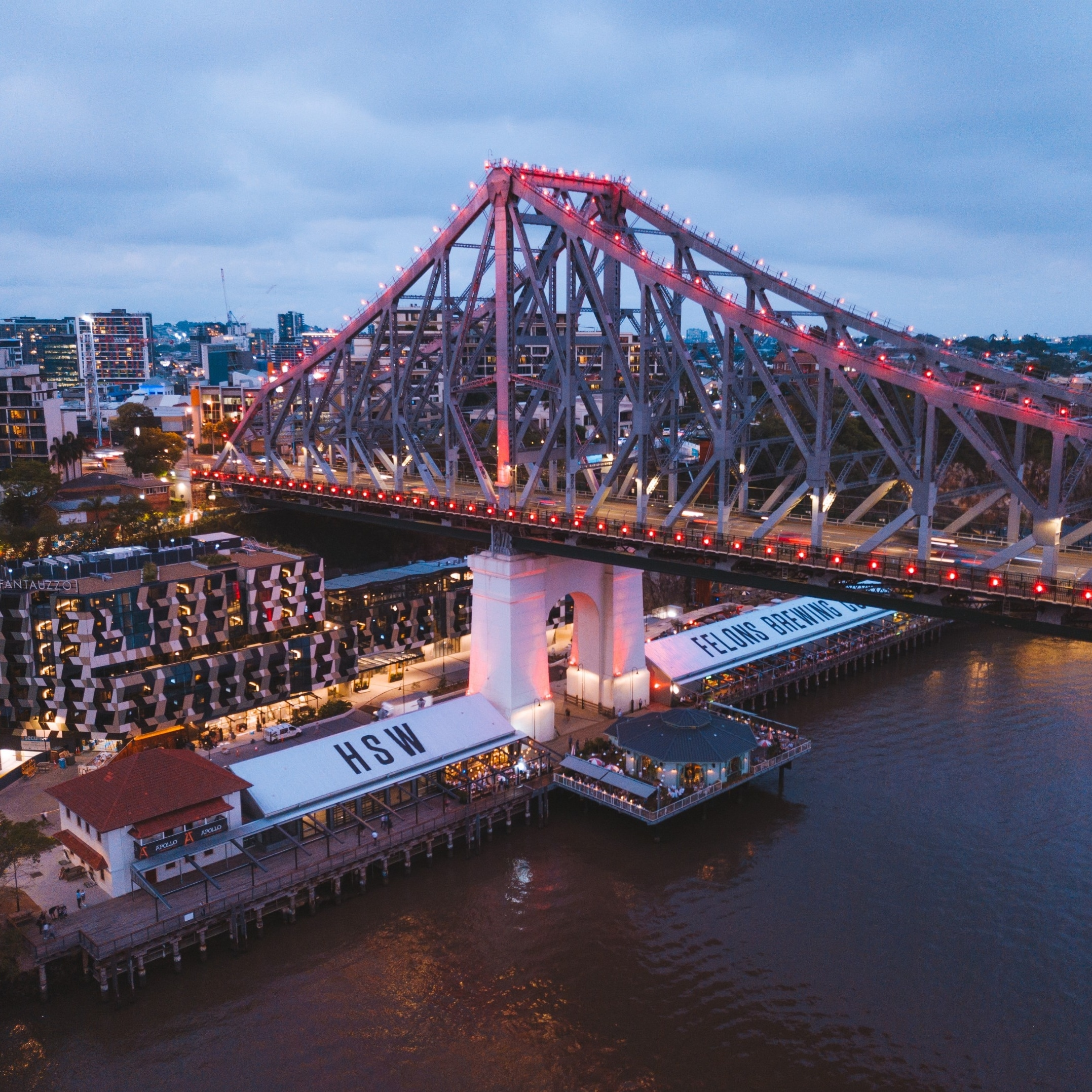 Aerial view of Howard Smith Wharves next to the Story Bridge at night © Tourism and Events Queensland