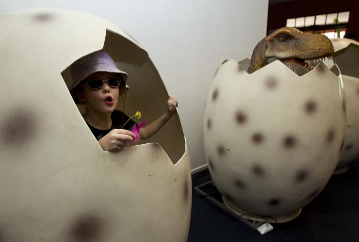 Child in a dinosaur egg at the National Dinosaur Museum © VisitCanberra