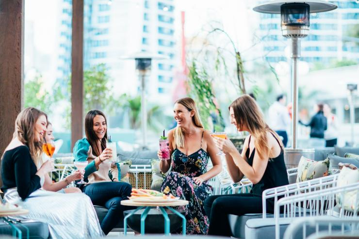 Friends at The Island Rooftop Bar on the Gold Coast © Destination Gold Coast