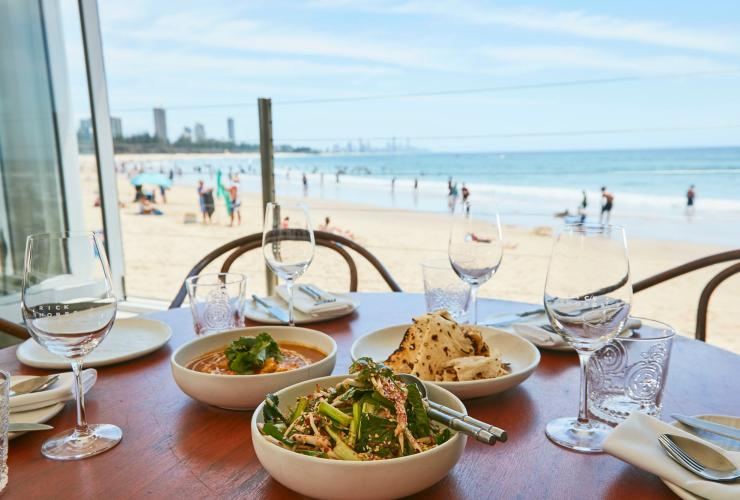Table set with food and drinks at Rick Shores Restaurant on the Gold Coast © Tourism and Events Queensland