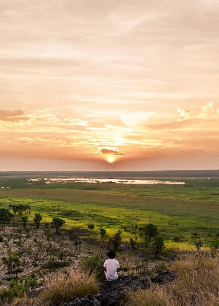 Man watching the sunset over Kakadu National Park © Tourism NT