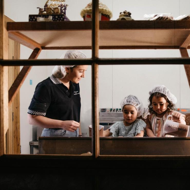Young girls enjoying a chocolate making lesson at Junee Licorice & Chocolate Factory © Destination NSW