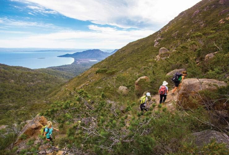 Woman walking the Freycinet Experience Walk in Freycinet National Park © Friendly Beaches Lodge / Great Walks of Australia