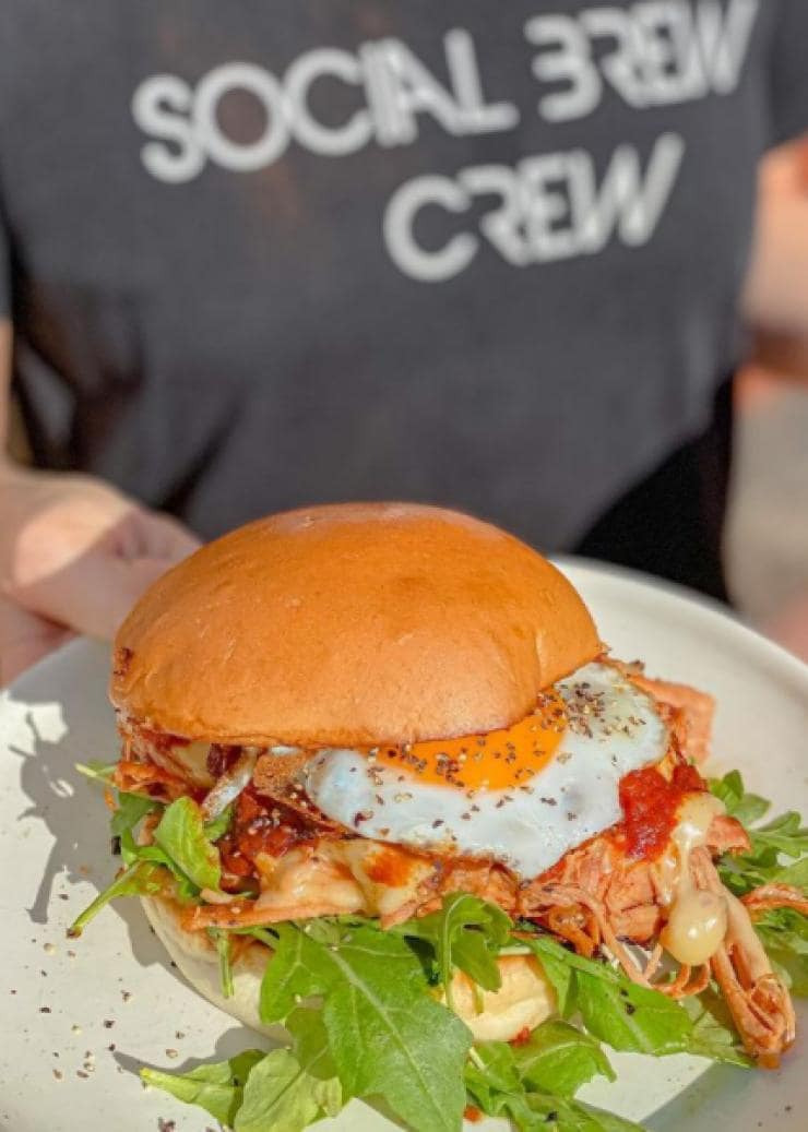 Burger being served by the Social Brew at Burleigh Heads in Queensland © Social Brew Burleigh