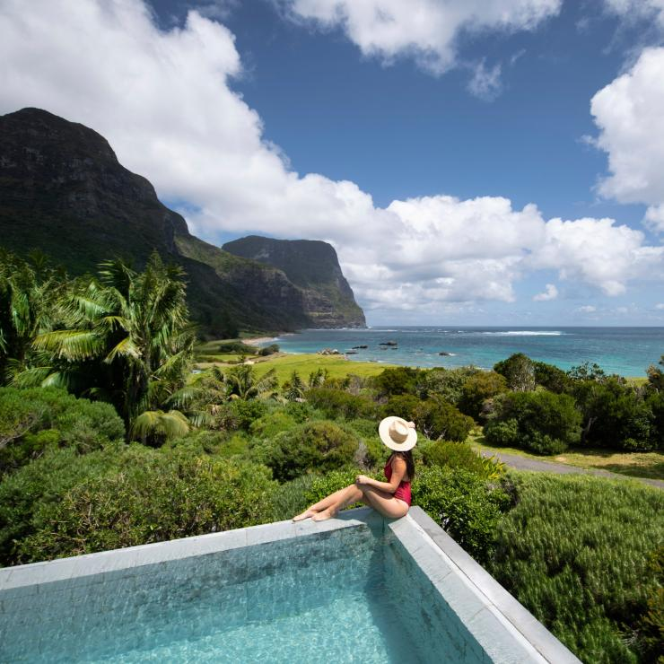 Woman relaxing by the pool at Capella Lodge, Lord Howe Island in New South Wales © tom-archer.com