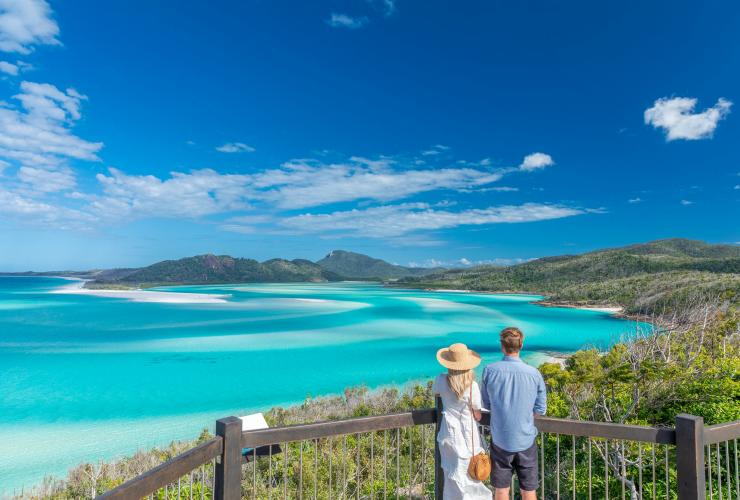 Couple admire view over the Whitsundays from Hill Inlet © Riptide Creative